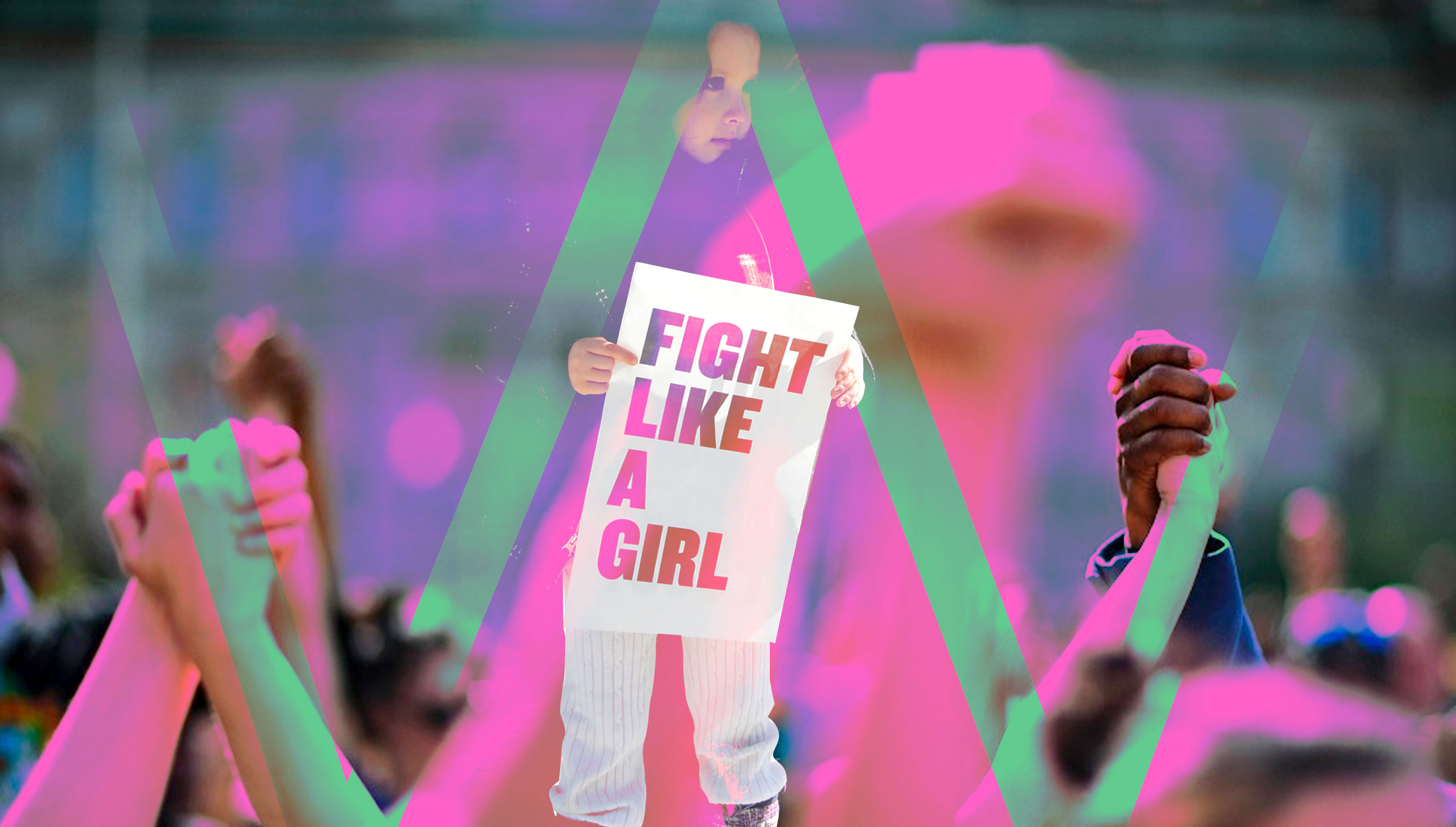 A Girl in an Event Holding a Poster Saying Fight Like a Girl