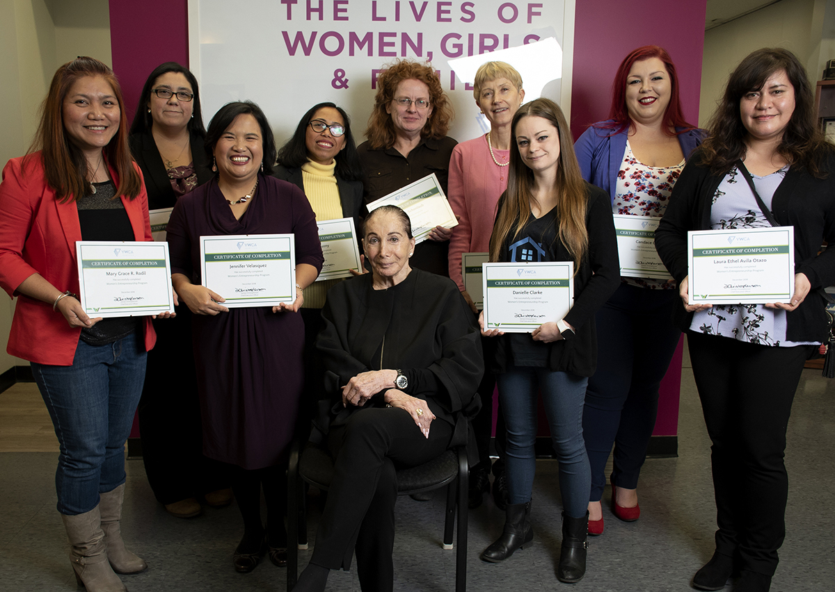 Milli Gould poses for a photo with the Women's Entrepreneurship Program graduates in 2019.