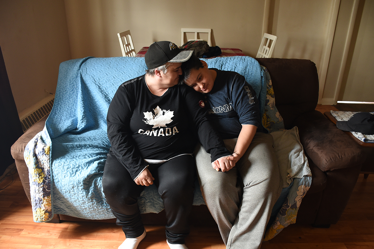Cathy (left) and Lindsey (right) pose for a photo in their apartment. They are getting their lives back together after spending an entire winter sleeping at Carole Anne's Place overflow centre.