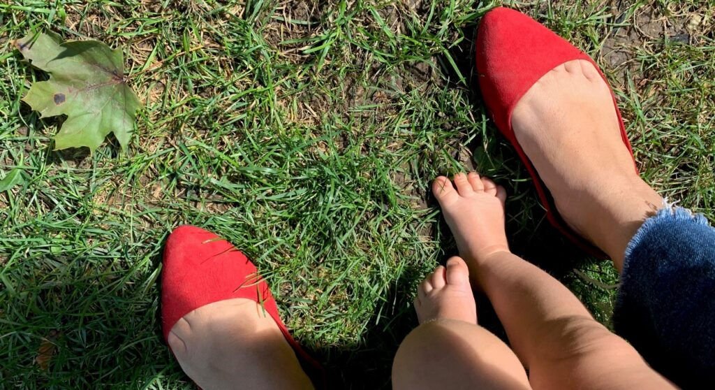 Red shoes and baby feet Walk a Mile in Her Shoes