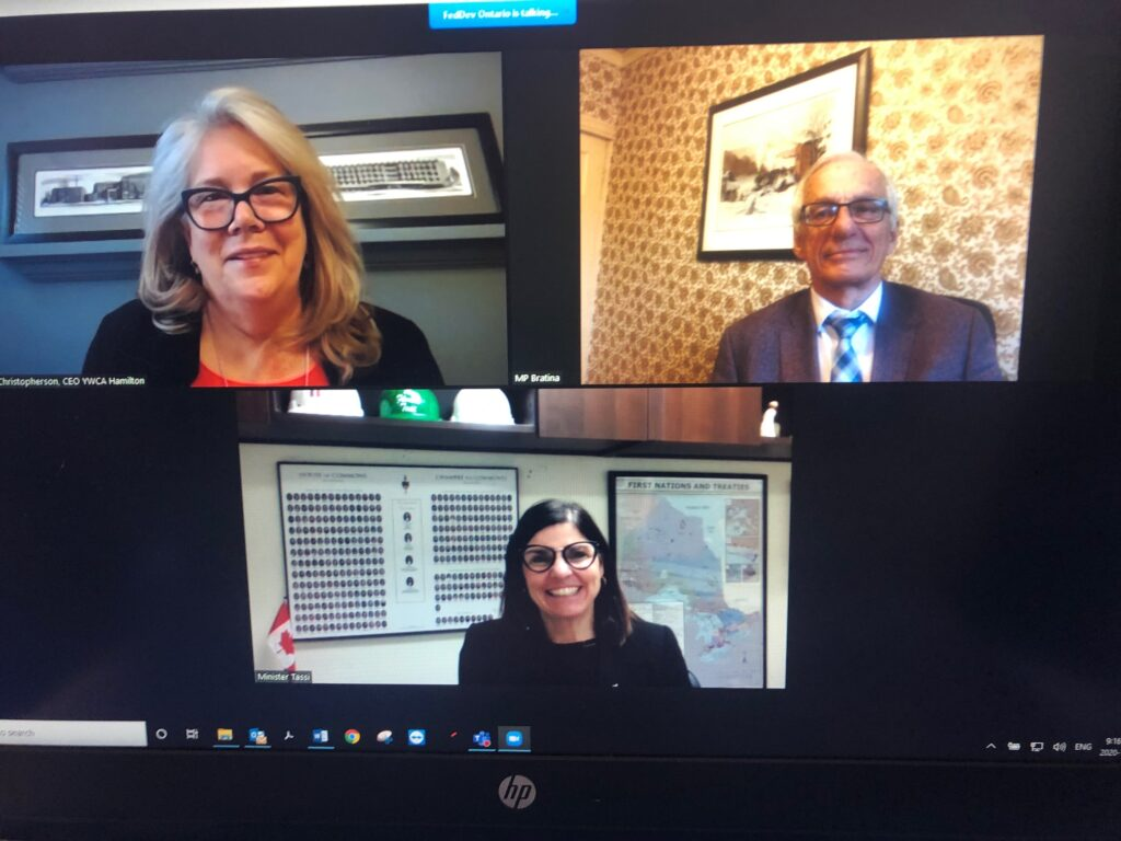 A screenshot of three people during a Zoom meeting.