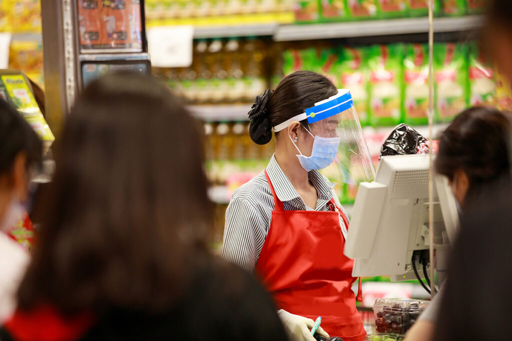 female supermarket cashier during covid-19