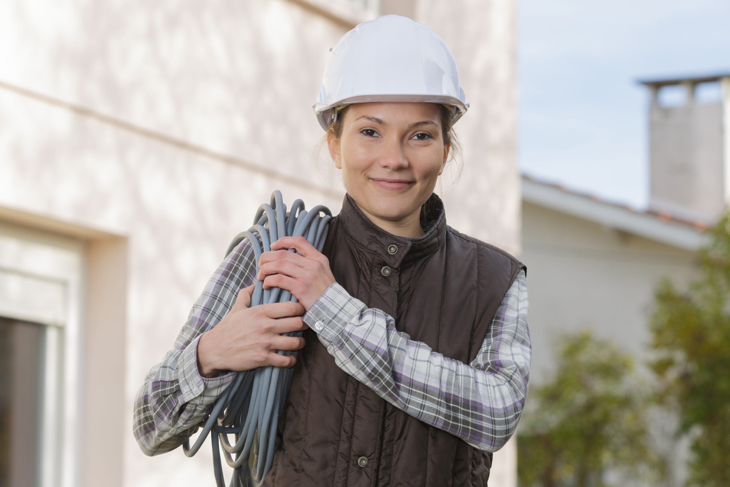 Woman wearing a hard hat helmet